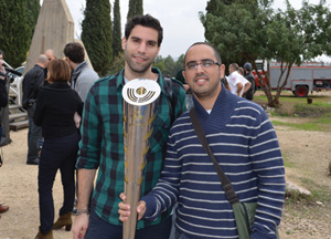 Yaki Marcus (left) and Yossi Cohen (right) hold their Maccabiah torch.