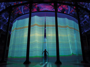 A visitor walks through the silicone threads of 'Curtain Call' at the Roundhouse theater in London. All images courtesy of Ron Arad.