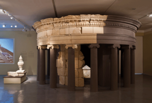 Herod's limestone sarcophagus is set within the circular upper section of  his reconstructed mausoleum. Courtesy of Elie Posner.