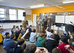 The Northwest Boychoir of Seattle listen to a presentation from three Terezin survivors.