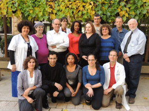 Michele Bashan-Haouzi (far left), Dr. Shlomo Maayan (third from left), Estelle Rubinstein  (third from right) with AIDS center staff.
