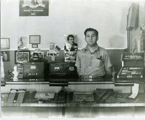A shop vendor at a Boyle Heights store in the 1950s. Courtesy of  Bruce A. Phillip