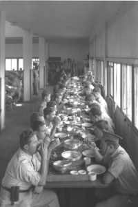 'The special night squad eat in the  dining hall at Kibbutz Ein Harod,' 1938.  Courtesy of The Government Press Office, Israel.