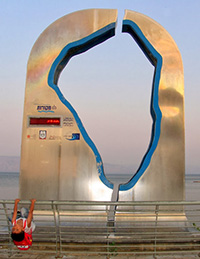 A sculpture along the lake records the Kinneret's water level. Photo by Esther Hecht.