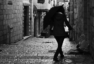 Beggar in Jerusalem Old City. Photo by Jerusalemgifts. Wikimedia Commons.
