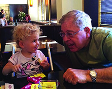 Richard Lakin with one of his eight grandchildren.