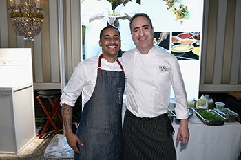 Chefs Joseph Johnson (left) and Itzik Mizrachi Barak at the Taste of Waldorf Astoria at Waldorf Astoria Hotel. Photo by Bryan Bedder/Getty Images for Waldorf Astoria Hotels & Resorts.