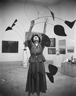 'Peggy Guggenheim with Alexander Calder's Arc of Petals at the Venice Biennale,' Venice, 1948. Peggy Gug­gen­heim Collection Archives, Venice. Photo Archivio meraphoto Epoche. Gift, Cassa di Risparmio di Venezia, 2005.