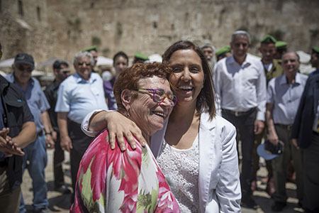Minister of Social Equality, Gila Gamliel seen with Holocaust survivors as they celebrate their belated Bar Mitzvah (Jewish coming of age ceremony) at the Western Wall, in Jerusalem's Old City, on May 2, 2016, ahead of the Israeli Holocaust Memorial Day. Photo by Hadas Parush/Flash90