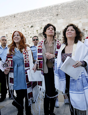 """Labour parliament member Stav Shaffir (2L), left-wing Meretz parliament members Tamar Zandberg (C) and Michal Rozin wear prayer shawls as they dance and pray at the Western Wall, Judaism's holiest site, in Jerusalem on March 12, 2013. """"Women of the Wall"""" fights for the right for Jewish women to conduct prayer services, read from a Torah scroll while wearing prayer shawls, and sing out loud at the women's section of the Western Wall. Photo by Miriam Alster/FLASH90"""