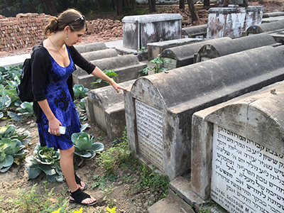 Shoshana pays respects to Flora, her great-grandmother and namesake.