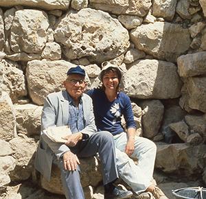 A young Eilat Mazar sitting with her grandfather, Benjamin Mazar. Courtesy of Eilat Mazar.