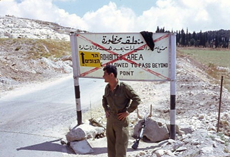A guard stands at the newly opened road up to Mount Scopus.